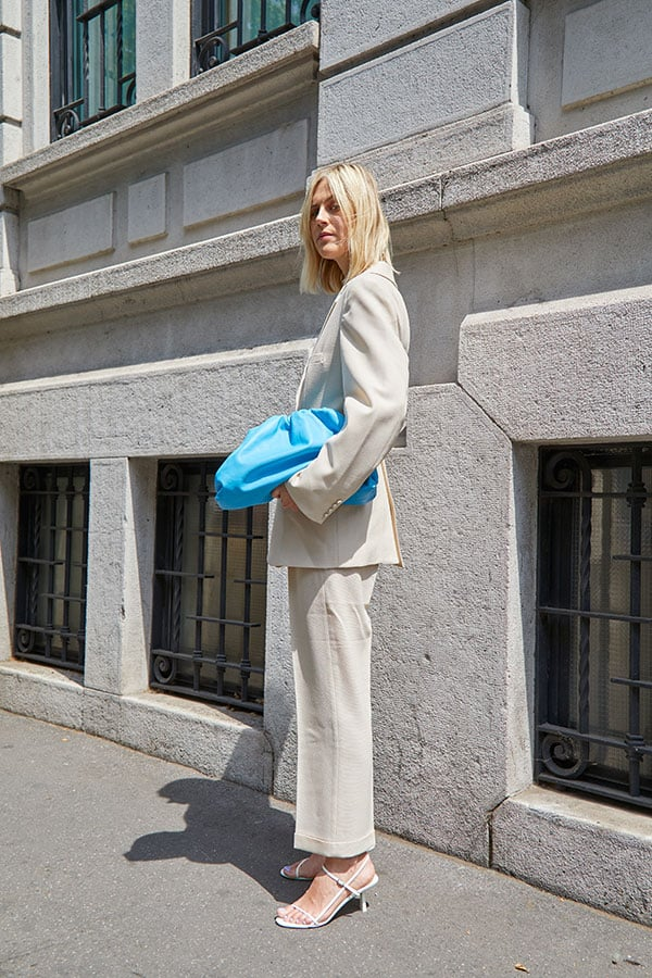 oversized blazer suit with slouchy bottega clutch exuding simplified timeless style