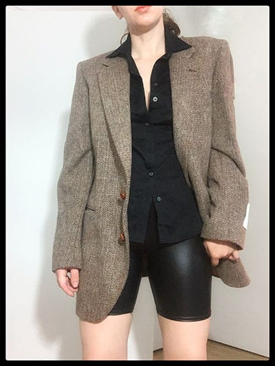 fitted blouse with bike shorts and oversized blazer
