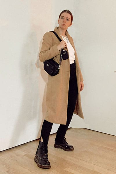 doc martens outfits winter with split ankle leggings and camel coat with nylon prada bag