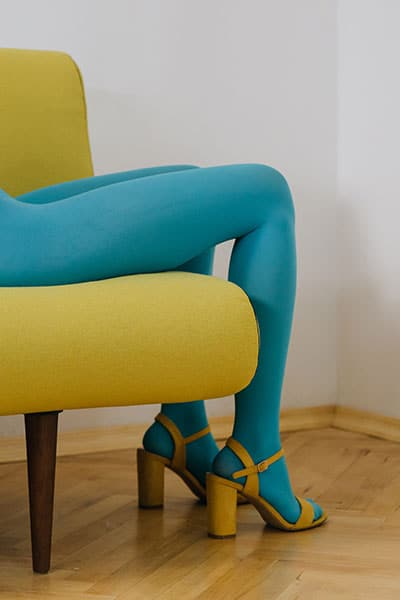 spring fashion trends 2021, colorful tights. turquoise blue tights with yellow heels
