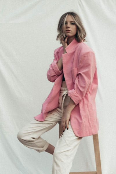spring fashion trends 2021, girl in pastel pink blazer and white trousers