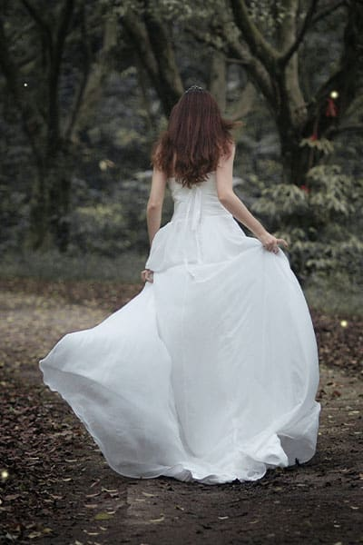 spring fashion trends 2021 royalty aesthetic, girl running in forest in ballgown