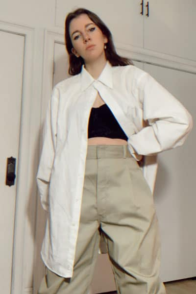spring fashion trends, wide leg khakis. style blogger gabrielle arruda wearing men's white button up with black corset underneath and wide leg khakis