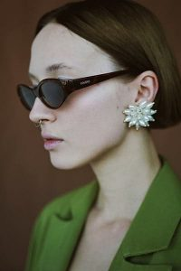 statement earrings and sunglasses on fashionable girl- how to develop your personal style by adding accessories