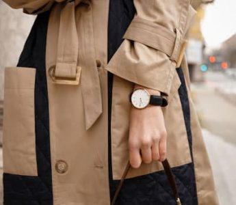 woman in trench coat with watch and black handbag, fashion details help express your personal fashion style